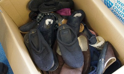 Used slippers in a box