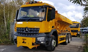 Gritters being driven out from a depot