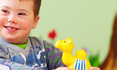 Smiling boy holding a toy