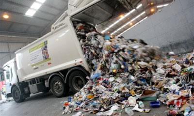 Lorry emptying rubbish