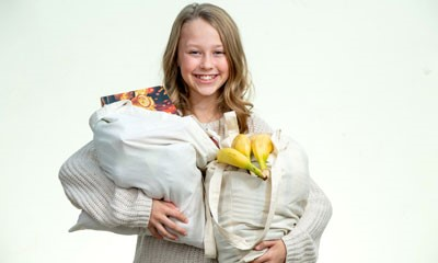 A young girl holding some shopping bags