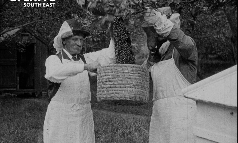 Black and white photo of two male bee keepers