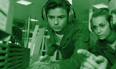 Young people wearing ear defenders